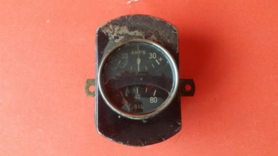 Stewart Warner, dual amp and oil gauge.